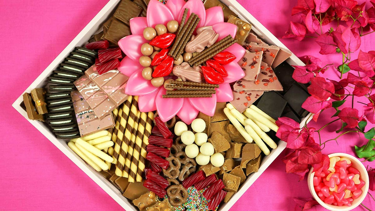 A charcuterie board filled with sweets.