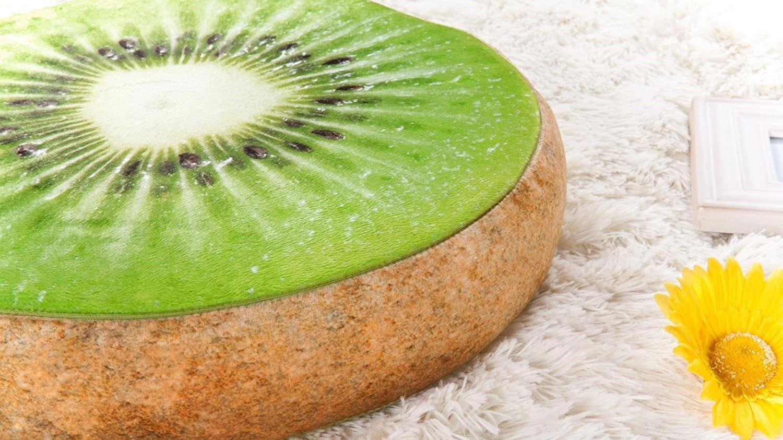 Kiwi pillow on a shag rug.