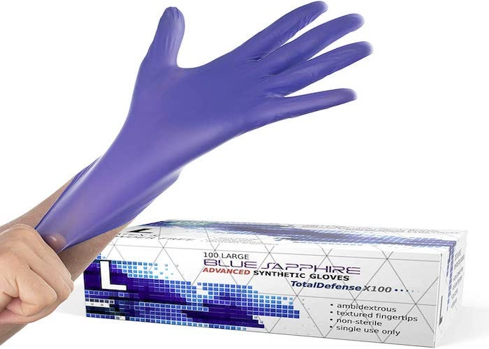 a hand putting on a blue stretchy glove