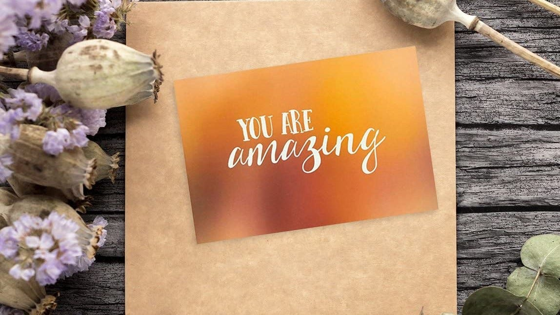 "A greeting card that reads ""You're Amazing."""