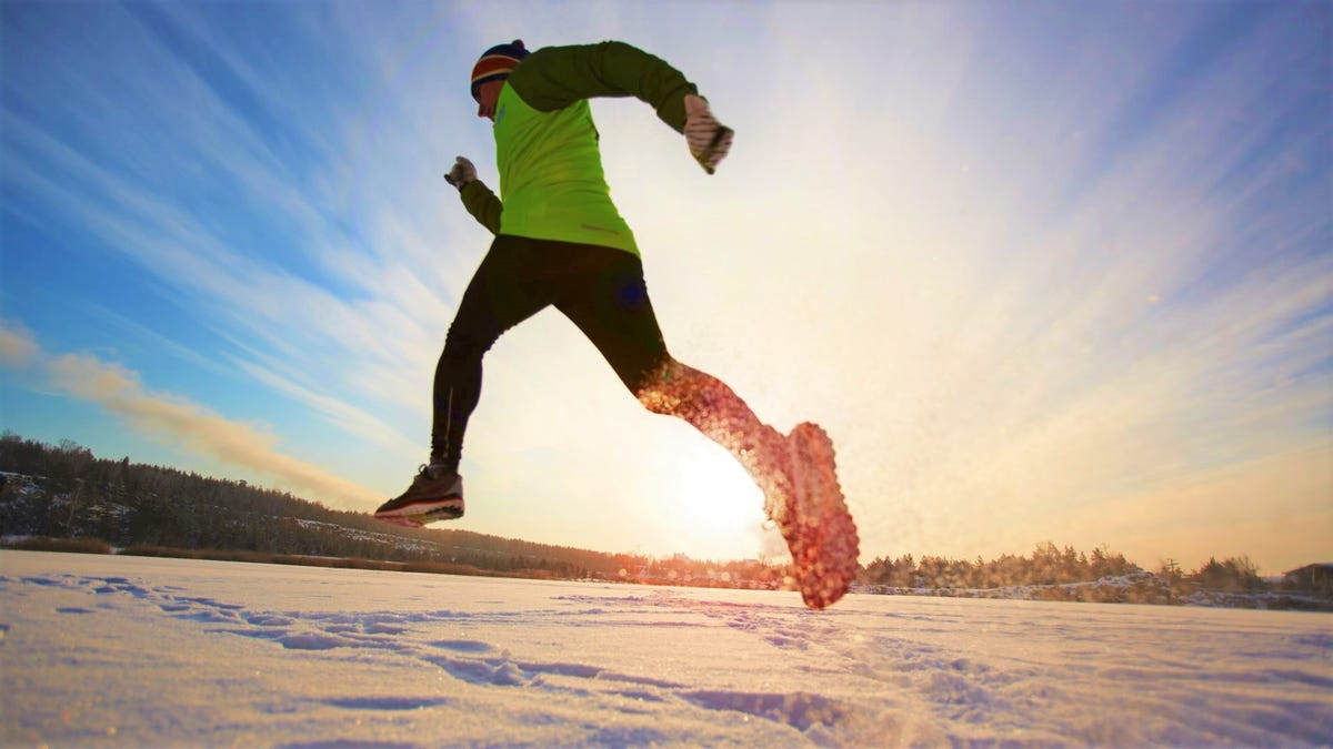 A man running in the snow.