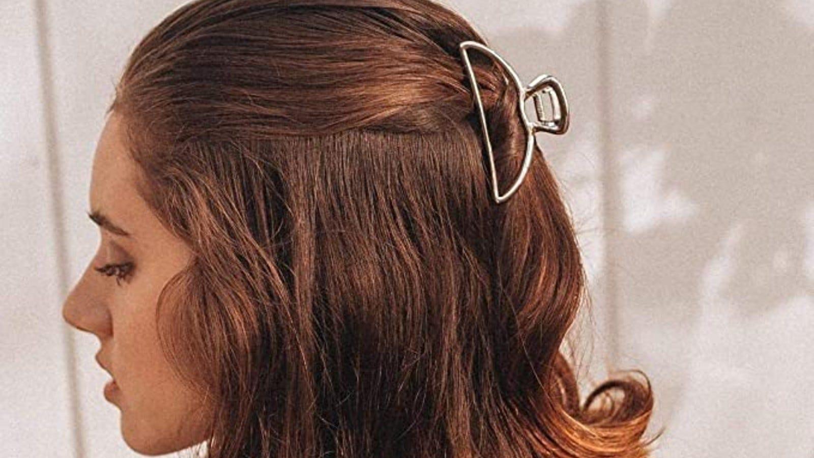 A woman wearing a Kitsch Metal Hair Clip.