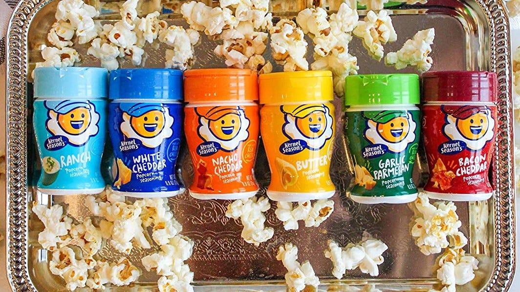 Six bottles of popcorn seasonings from Kernel Season's.