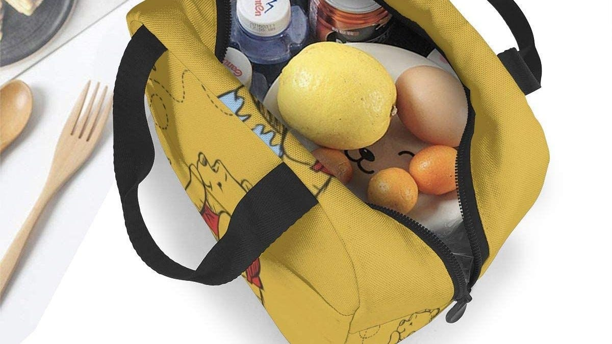 Winnie the Pooh lunch bag stuffed with food and drinks.