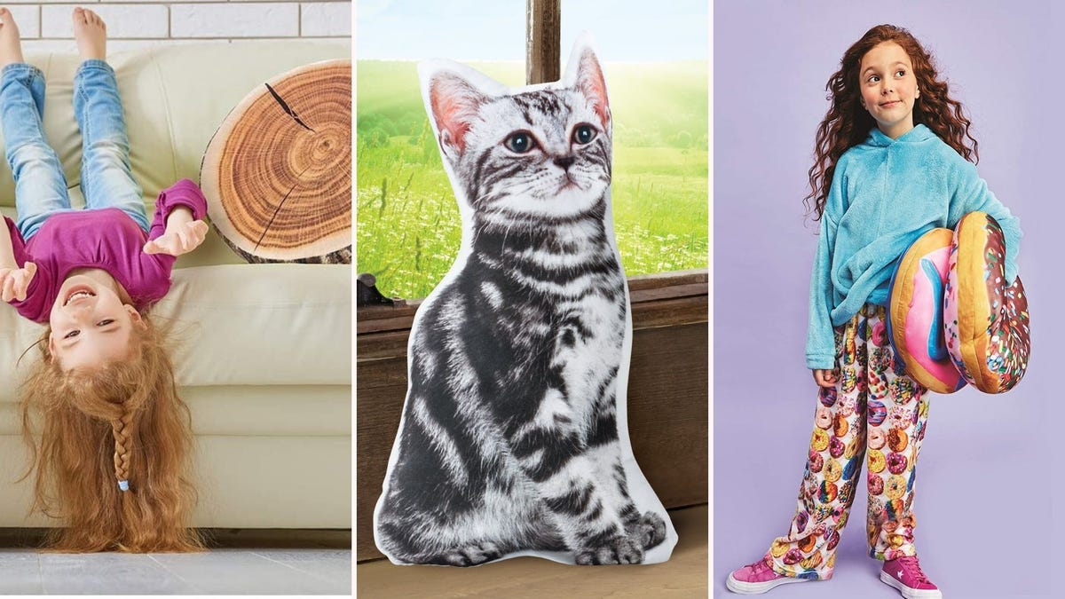 A little girl on a couch with a tree stump pillow, a tabby cat pillow, and a little girl holding two donut pillows.