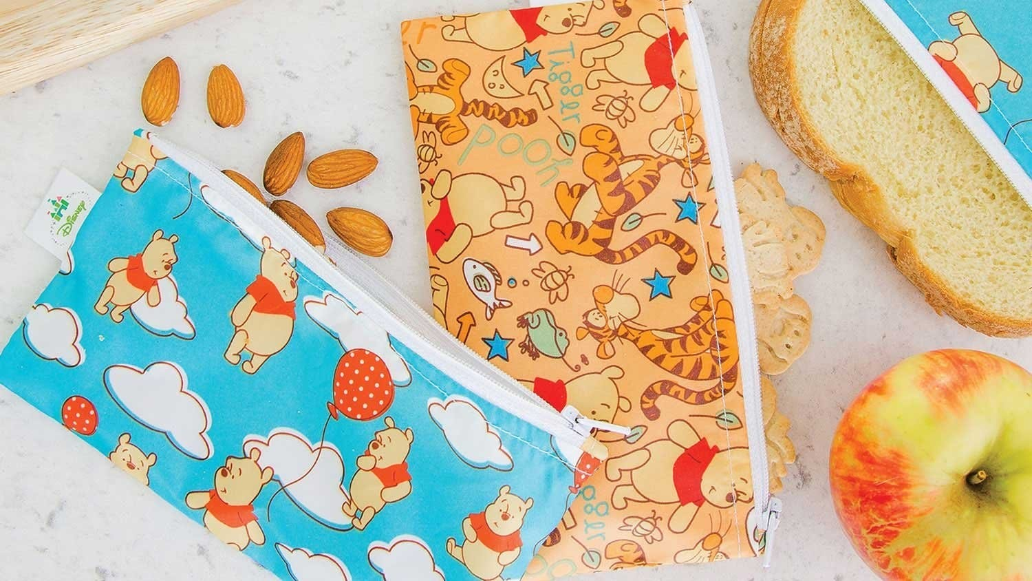 Two reusable snack bags featuring Winnie the Pooh and friends.