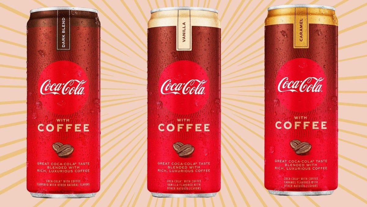 Three cans of Coca-Cola with Coffee in caramel, vanilla, and dark blend.