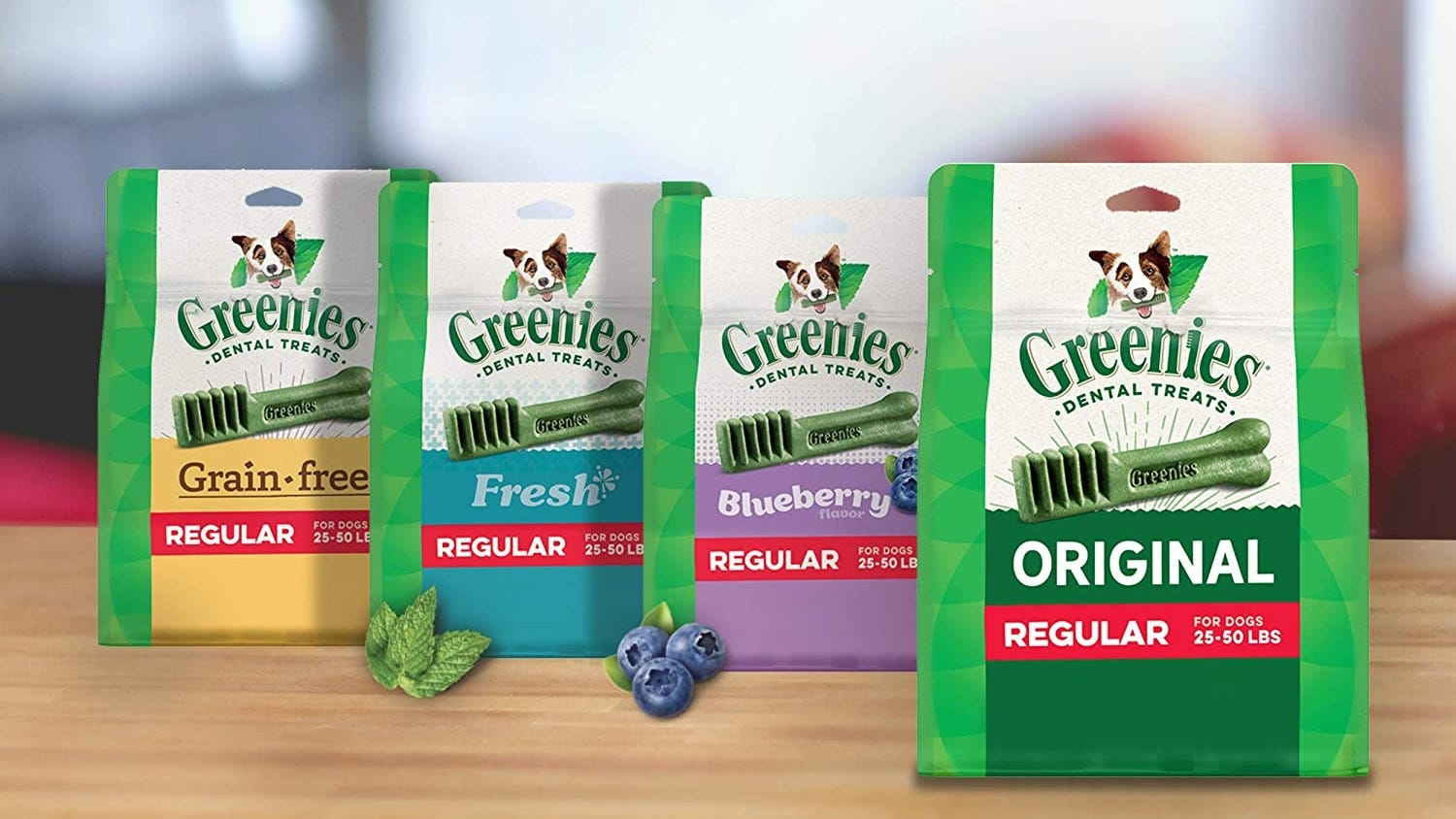 Various flavors of Greenies on a table.