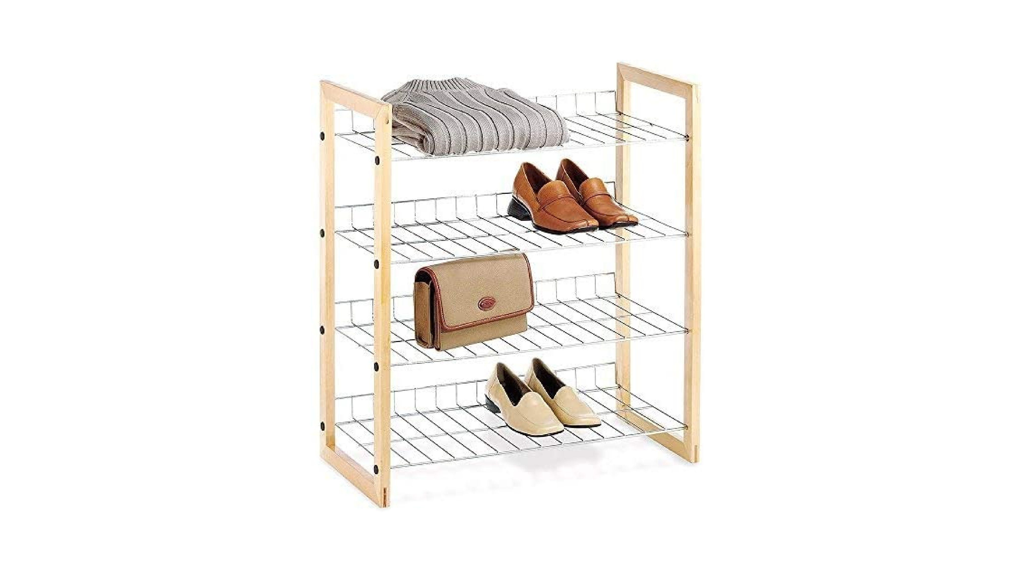 Shoe rack with shoes and other items on it.