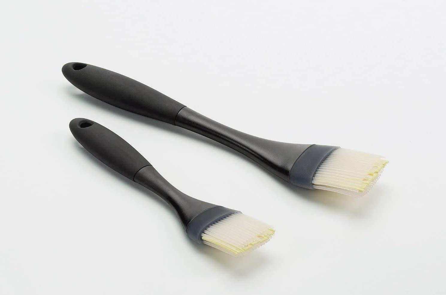 Two black-handled silicone pastry brushes