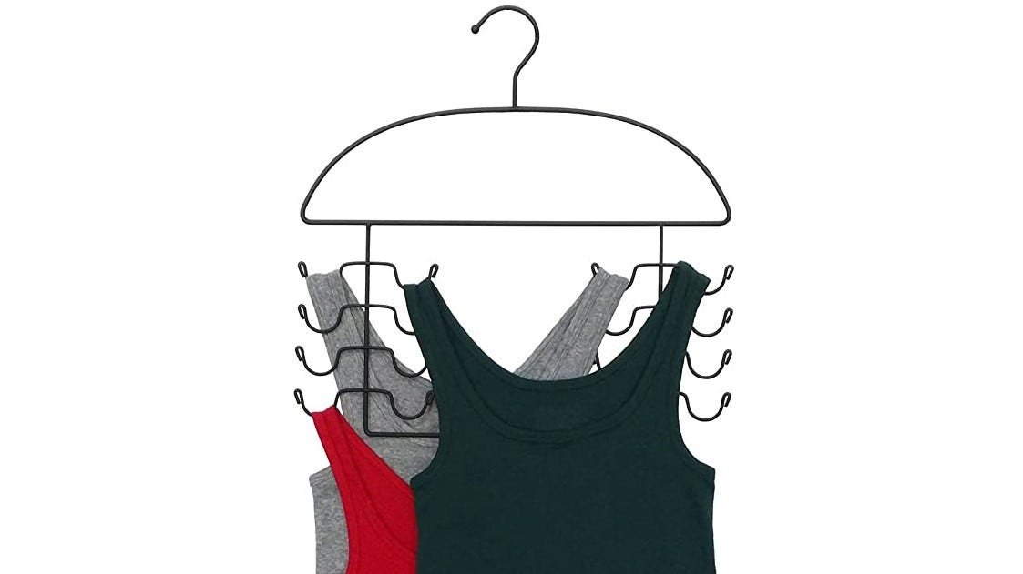 Tank tops hanging together on one multi-clothing hanger.