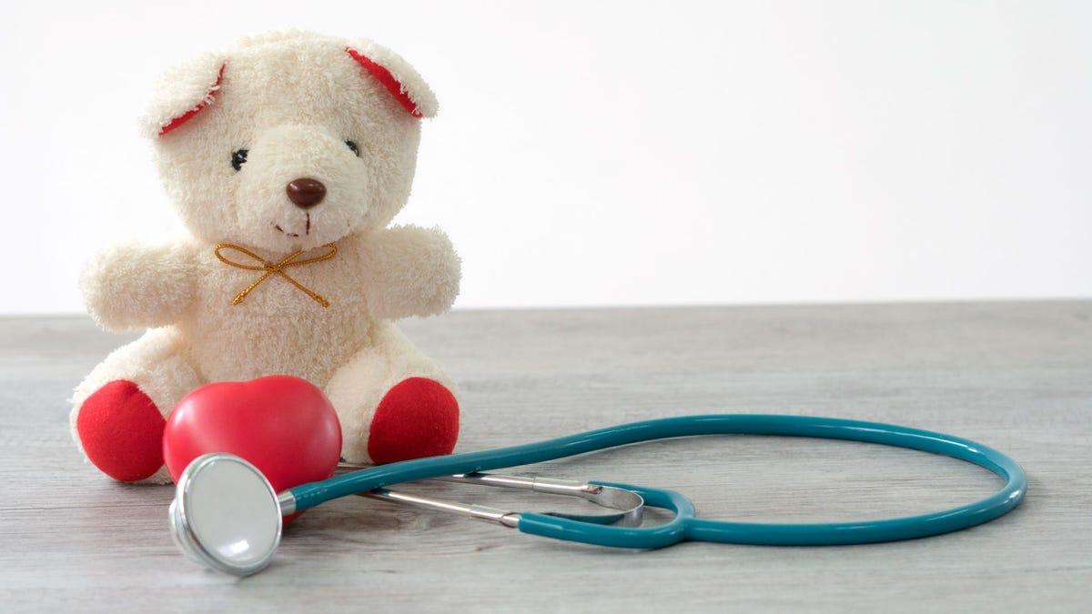 Valentines Day teddy bear sitting next to a stethoscope.
