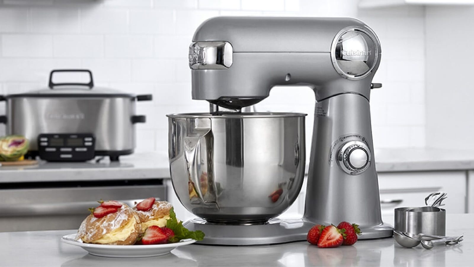 A Cuisinart stand mixer with gorgeous pastries next to it.