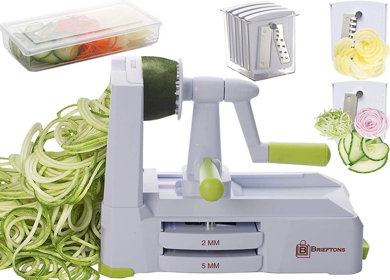 A white veggie spiralizer making zucchini noodles.