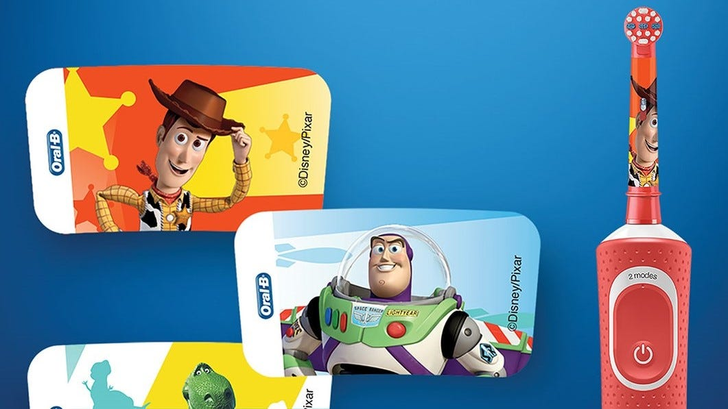 Toy Story toothbrush with images of some of the stickers that come with it.