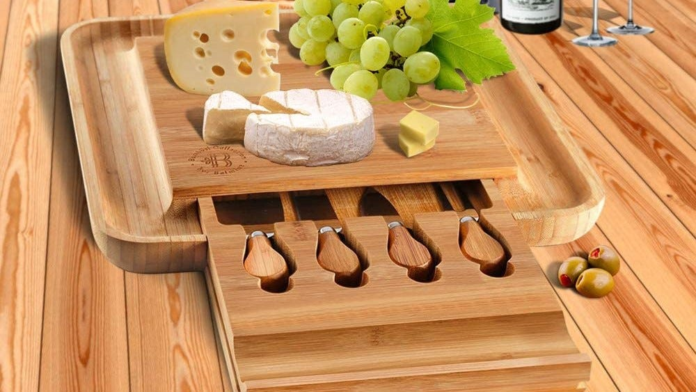 Charcuterie board topped with cheese and fruit.