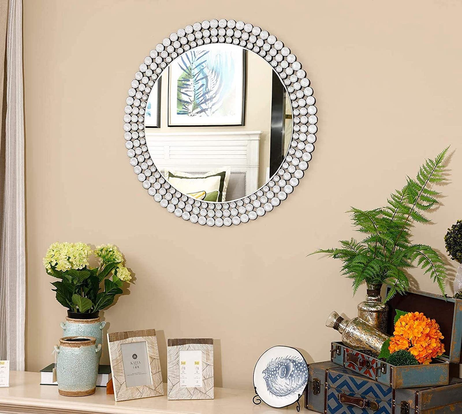 Round wall mirror with three layers of mirrored dots surrounding it