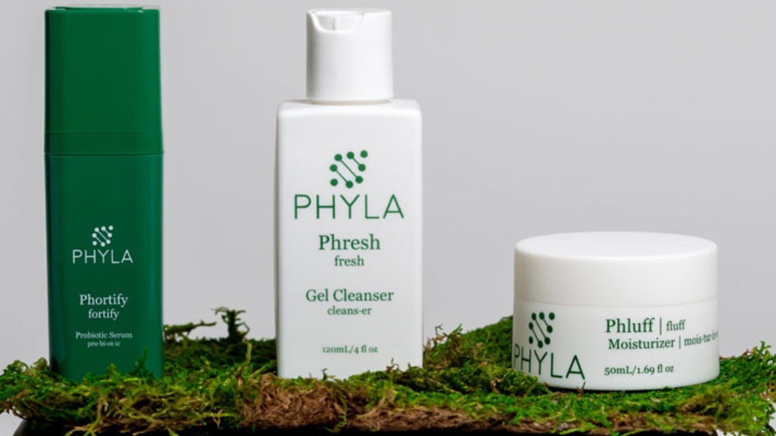 Three bottles of Phyla skincare products.