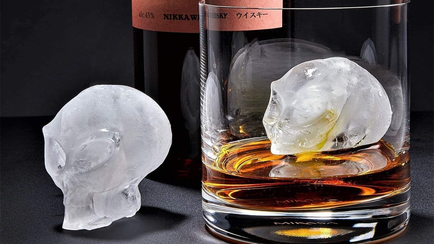 3D alien ice cubes with a glass of whiskey.