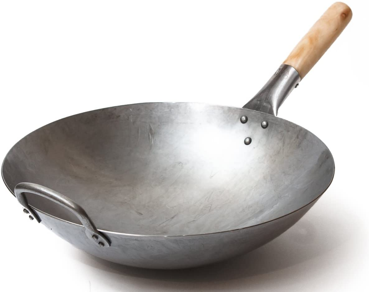 A silver wok with a rounded hande on one side and a wood handle on the other