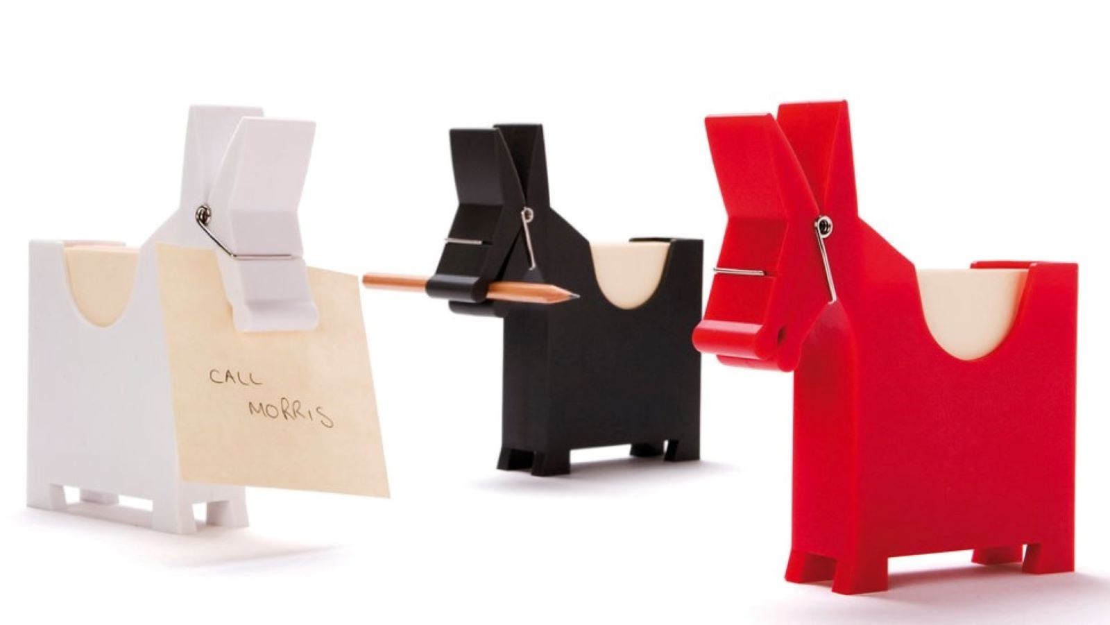 Three donkey-shaped sticky note holders in white, black, and red.