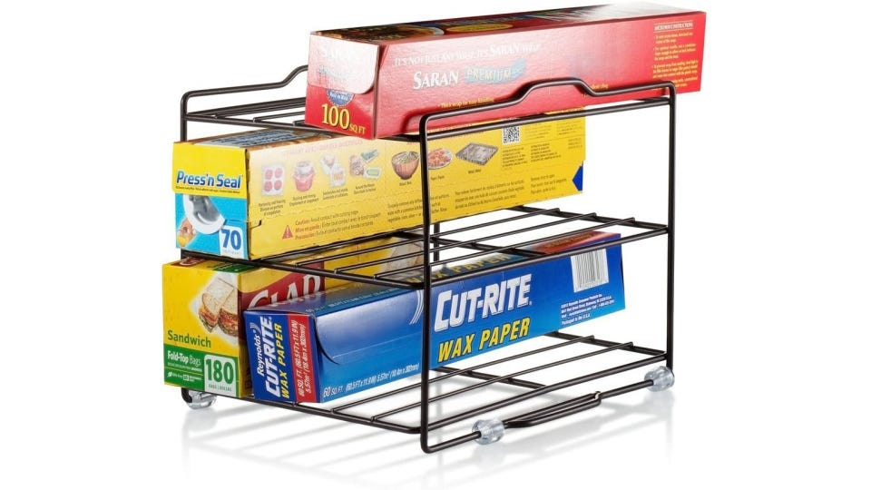 A three tiered organizer rack fit for different types of kitchen wraps and baggie boxes.