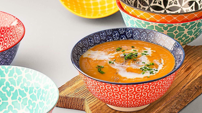 Colorful soup bowls and some squash soup.