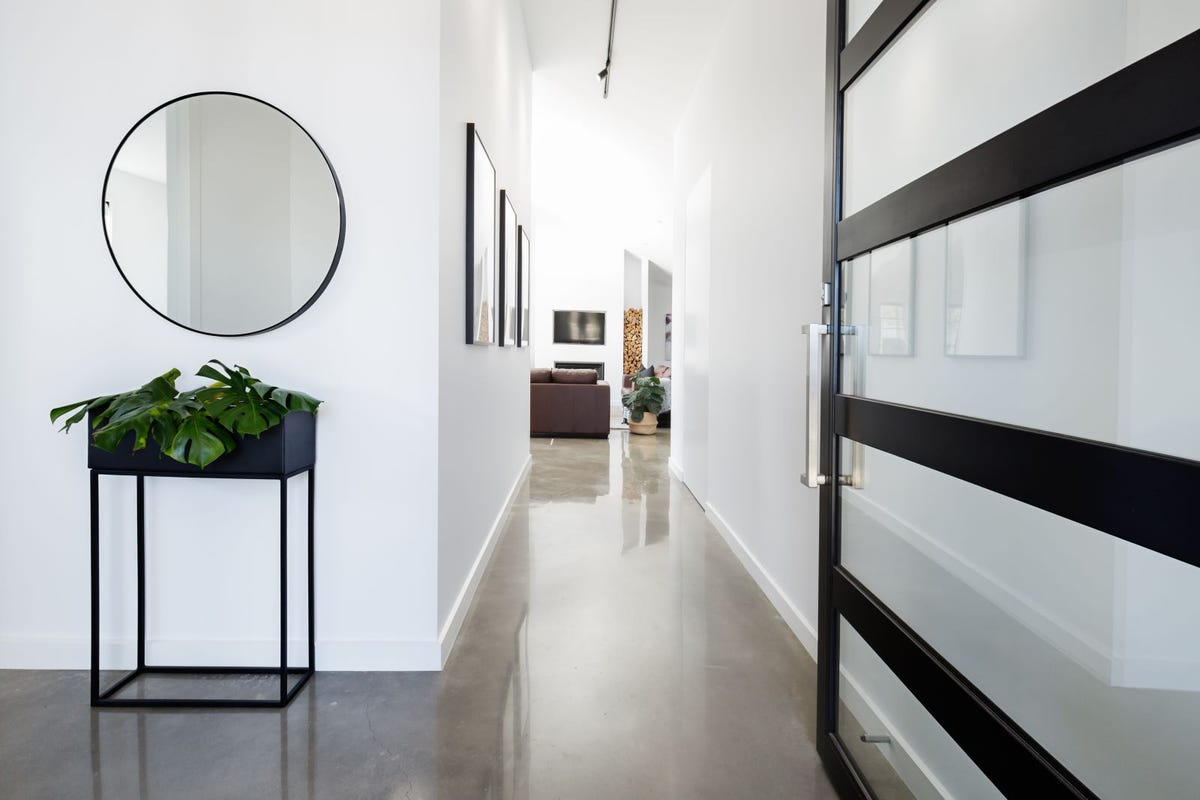 A hallway featuring a beige concrete floor.