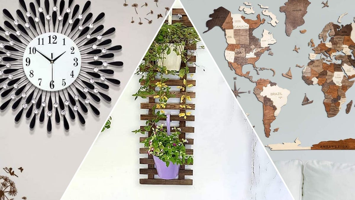 A feathered clock, a hanging vertical wood planter, and a wood map of the world