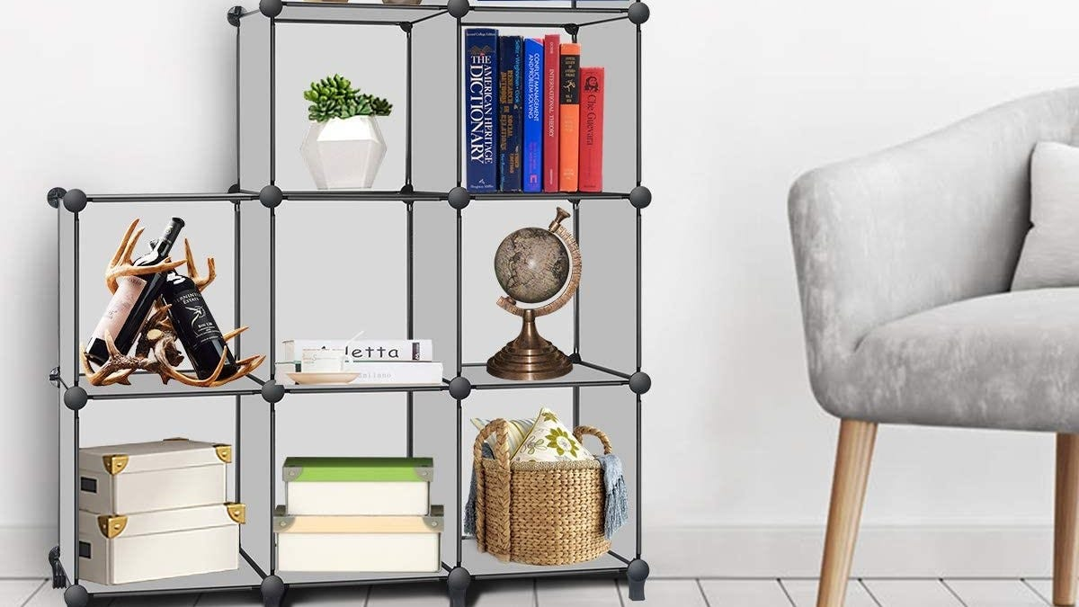 The TomCare Cube organizer being used as a living room shelf.