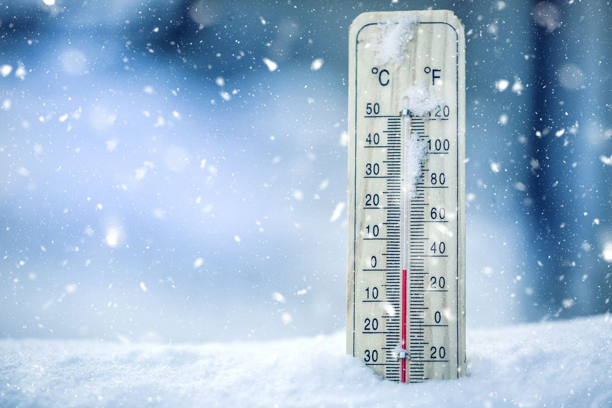 A thermometer is placed in snow and snows the temperature.