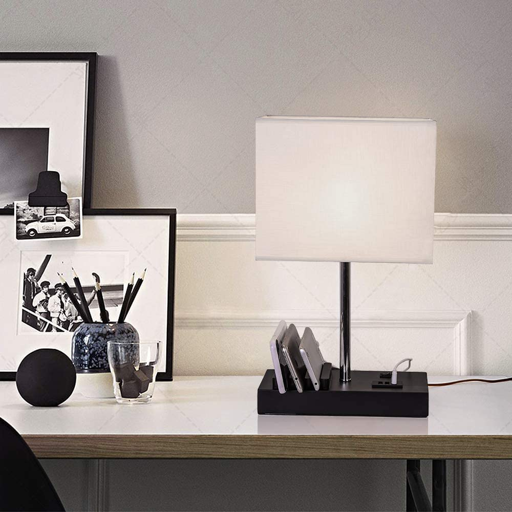 Black and white desk setup with rectangular lamp in the center
