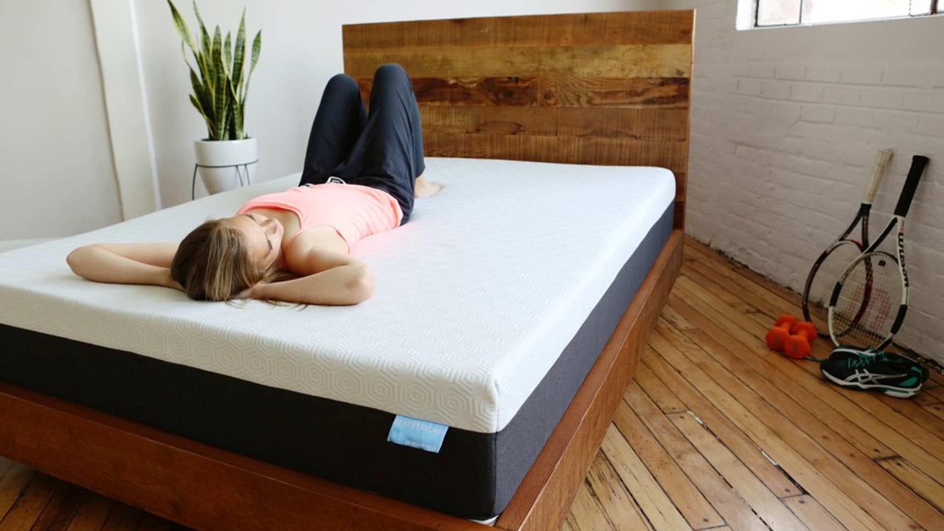 A woman laying on a Bear mattress.