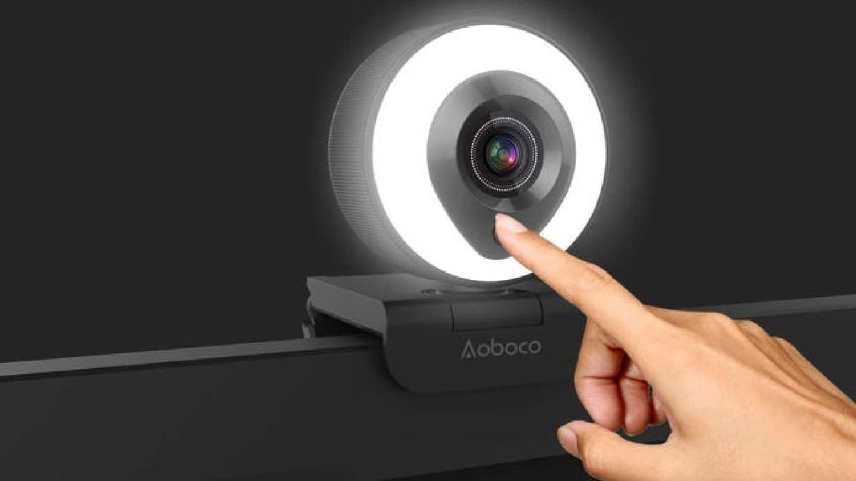 round light-up webcam attached to a computer
