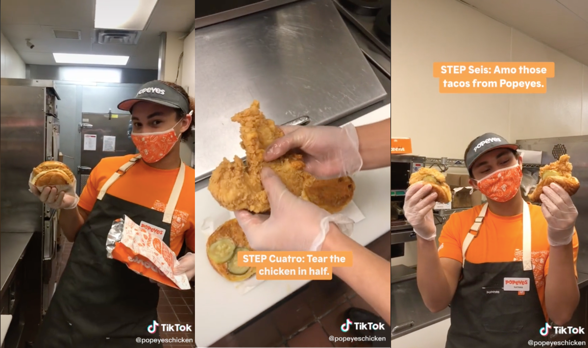 A Popeyes employee demonstrating how to fold a Popeyes chicken sandwich into a taco.