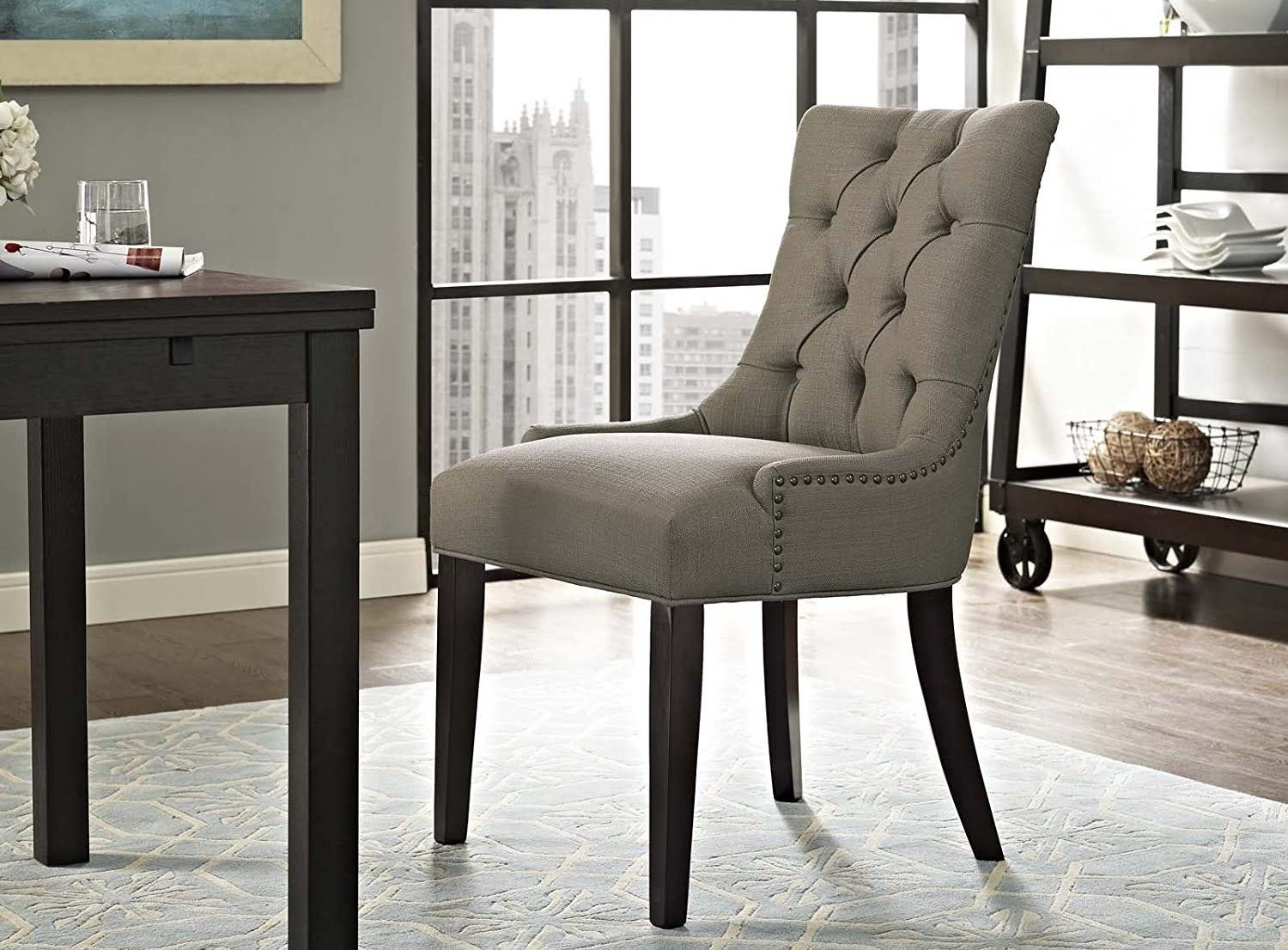 The Modway Regent Modern Elegant Button-Tufted chair in Granite sitting at a desk.