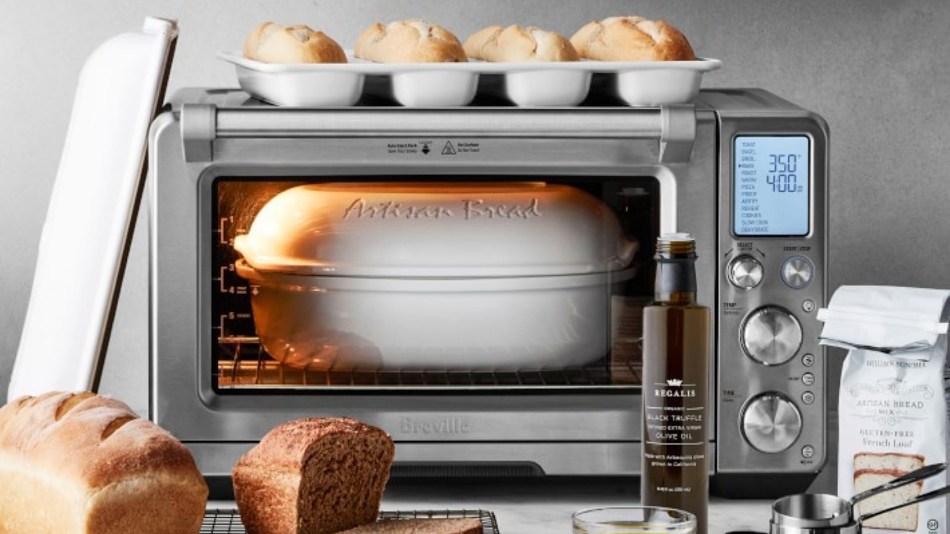 Toaster oven with white casserole dish inside