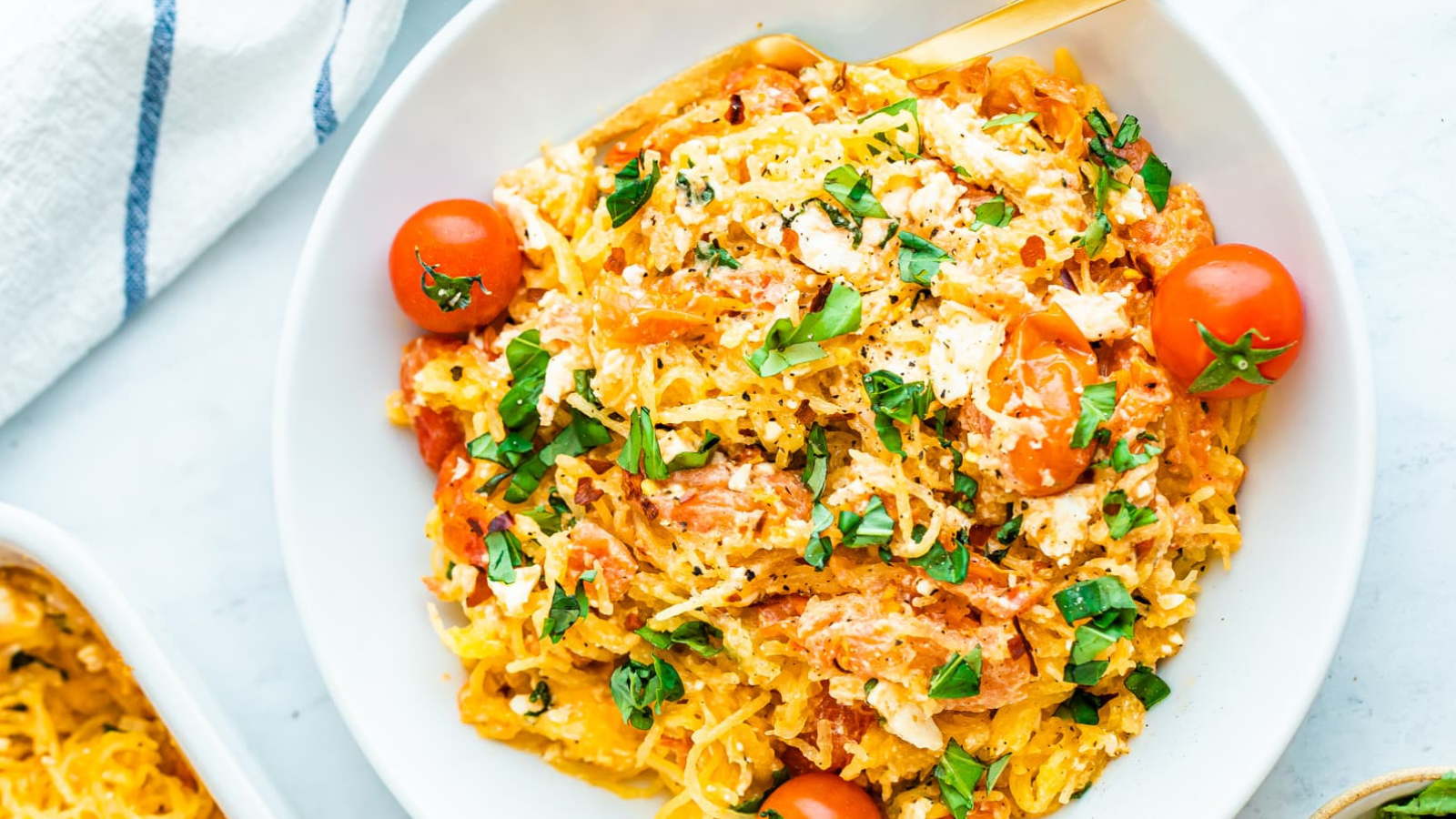 Baked feta with spaghetti squash on a plate.