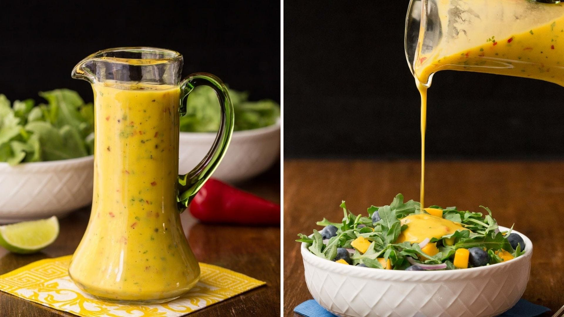 A dressing pourer full of mango salad dressing and some being poured on a salad.