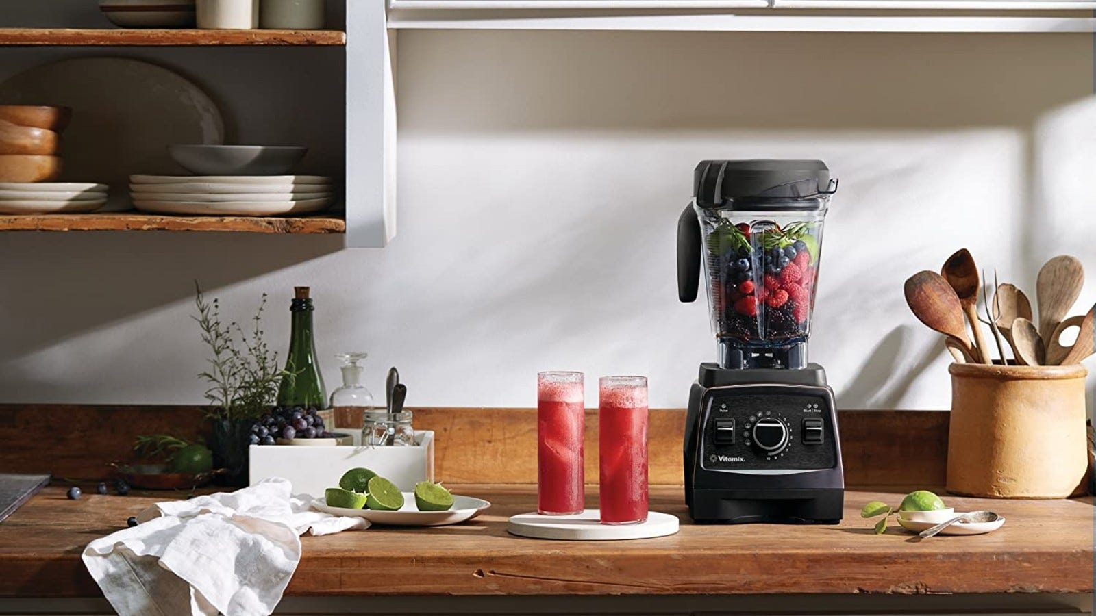 vitamix blender with cups of juice