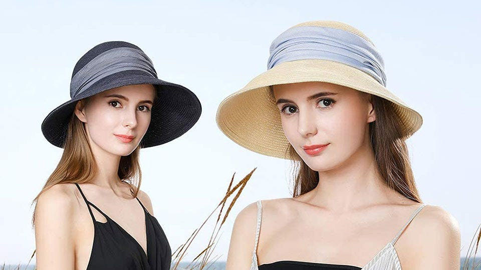 Women wearing wide-brim straw hats.