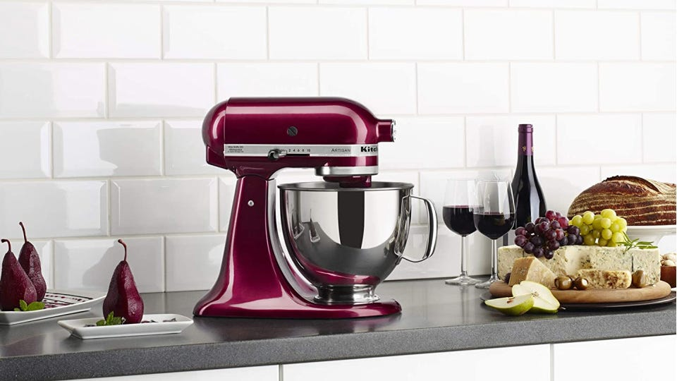A merlot colored KitchenAid mixer with poached pairs, red wine and cheese nearby.