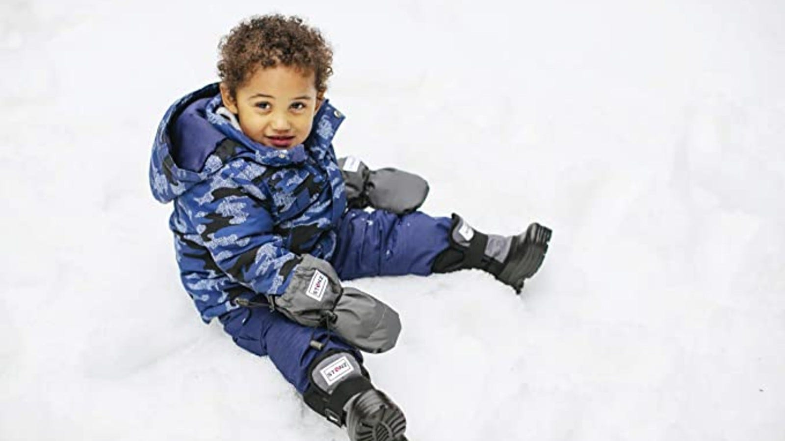 toddler boy in the snow
