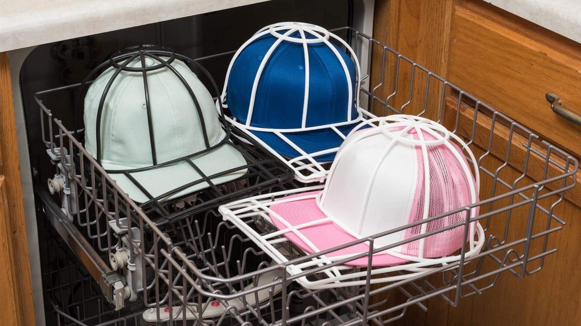 Three baseball hats in Ballcap Buddys in a dishwasher.