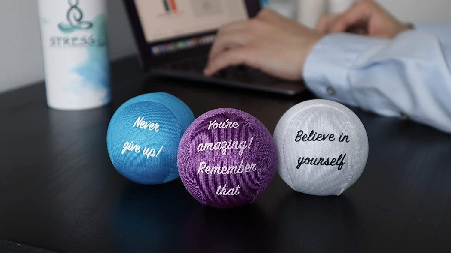 Three stress balls with motivational quotes.