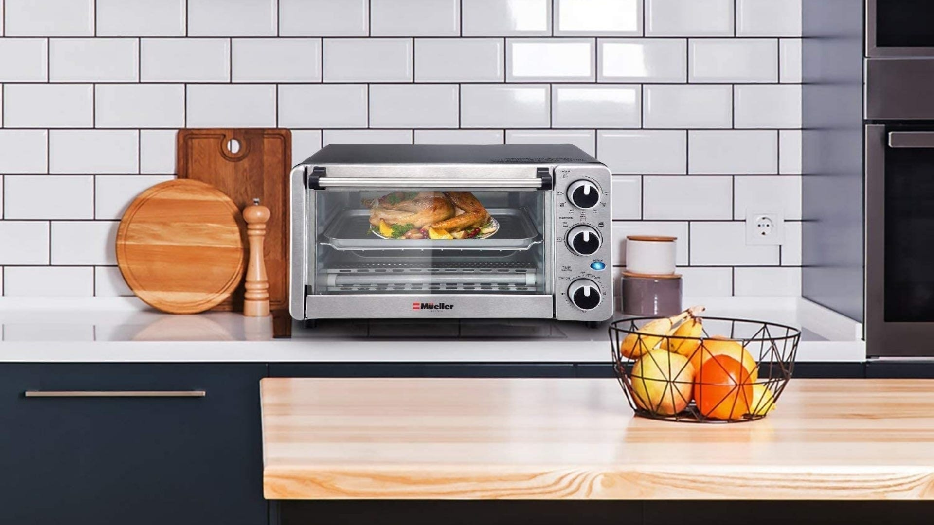 Toaster oven sitting on kitchen countertop