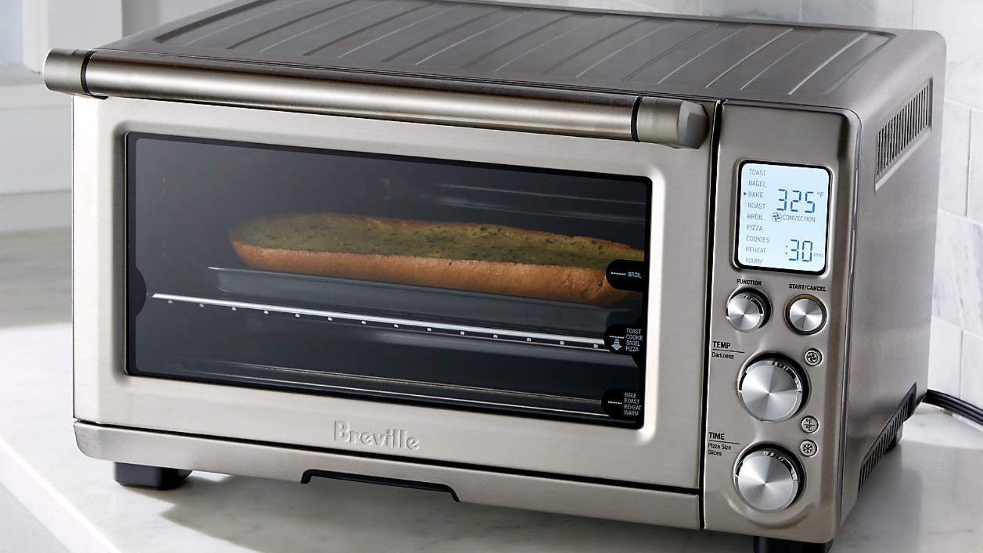 Toaster oven with garlic bread inside