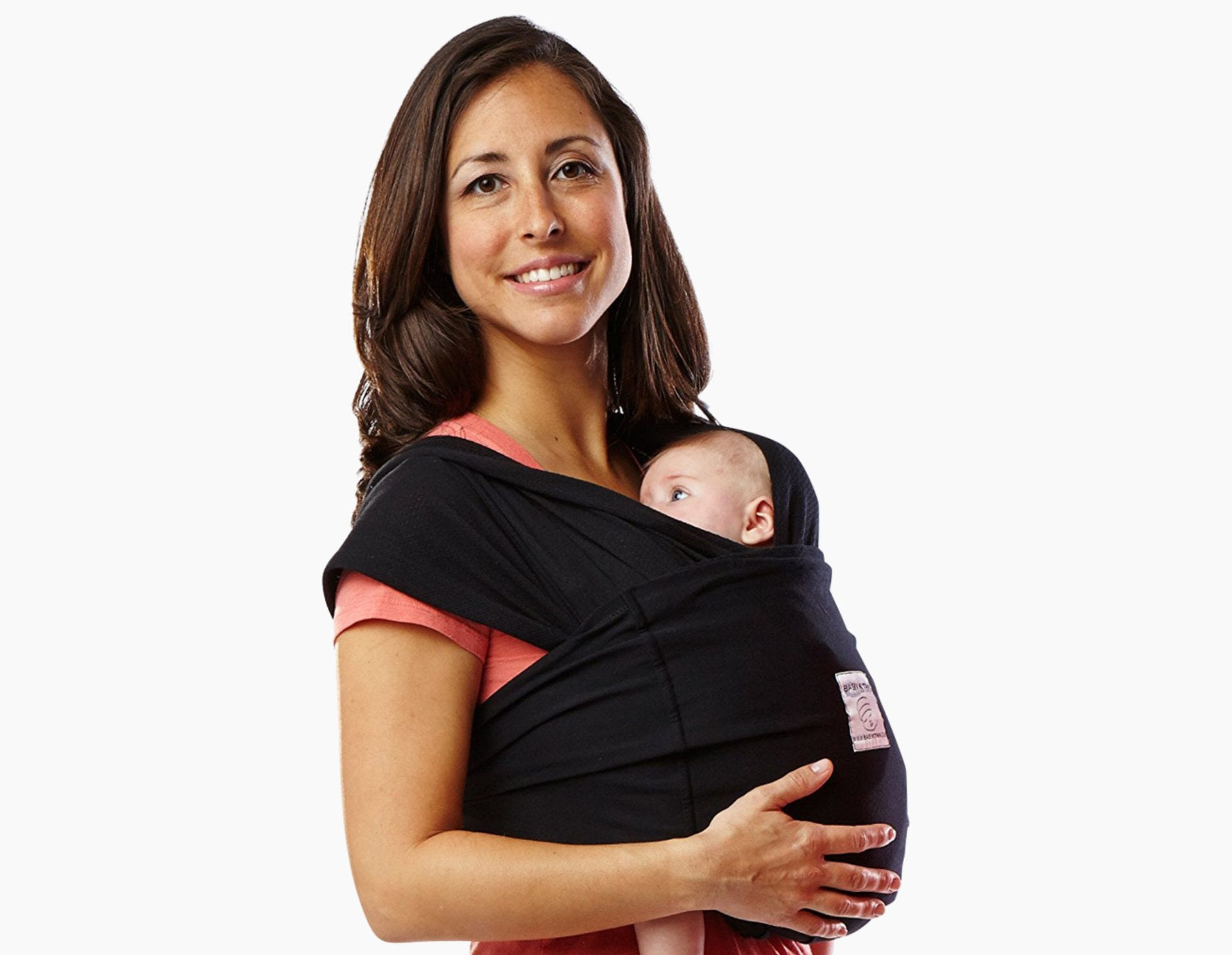 Woman carrying a newborn in the Baby K'Tan carrier.
