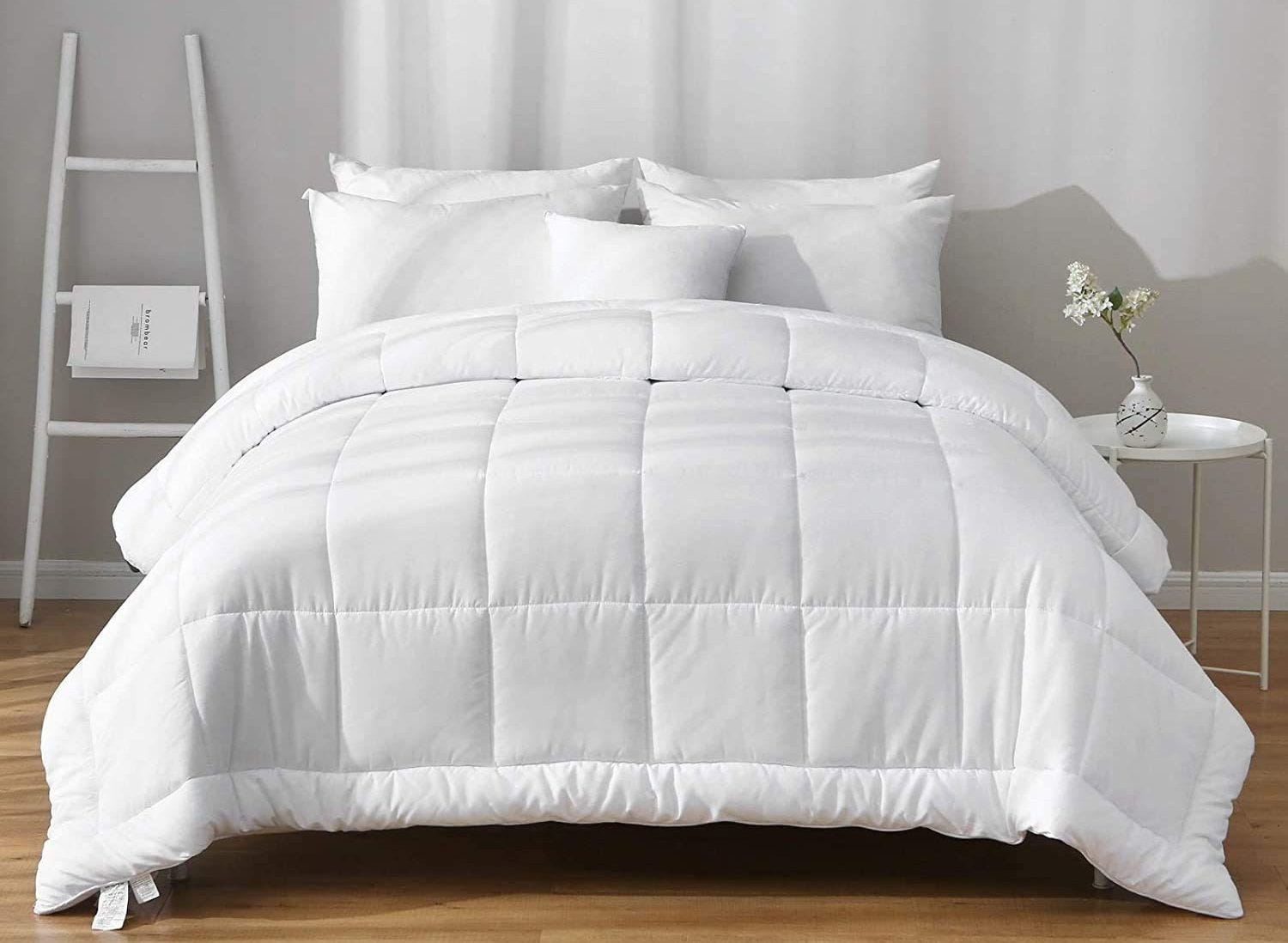 White quilted comforter on a bed.