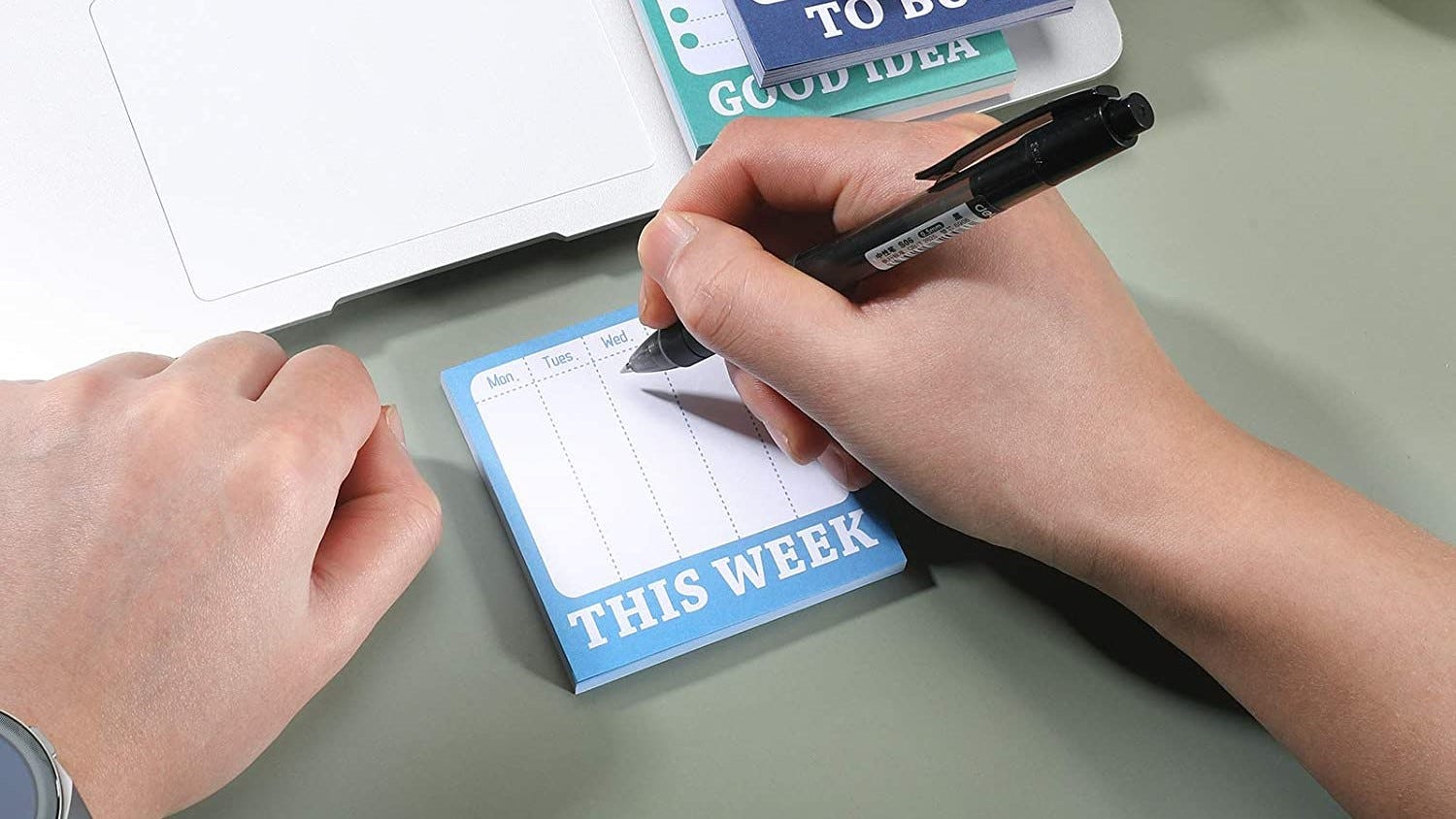 Person writing out their weekly to-do list.